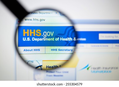 LISBON, PORTUGAL - February 24, 2015: Photo of United States Department of Health and Human page on a monitor screen through a magnifying glass.