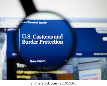 LISBON, PORTUGAL - February 24, 2015, 2014: Photo of the u.s. customs and border protection page through a magnifying glass.