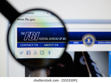 LISBON, PORTUGAL - February 24, 2015, 2014: Photo of the the fbi federal bureau of investigation page through a magnifying glass.