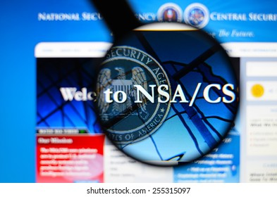 LISBON, PORTUGAL - February 24, 2015, 2014: Photo of the nsa-national security agency  page through a magnifying glass.