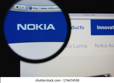 LISBON, PORTUGAL - FEBRUARY 3, 2014: Photo of Nokia homepage on a monitor screen through a magnifying glass.