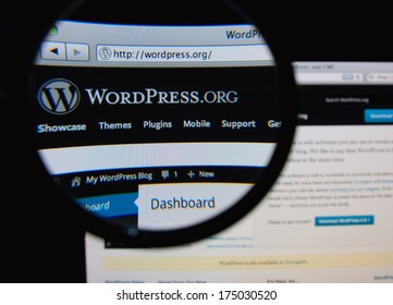 LISBON, PORTUGAL - FEBRUARY 5, 2014: Photo of WordPress.org homepage on a monitor screen through a magnifying glass.