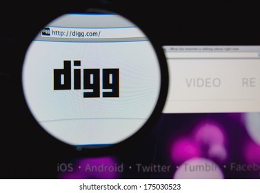 LISBON, PORTUGAL - FEBRUARY 5, 2014: Photo of Digg homepage on a monitor screen through a magnifying glass.