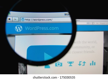 LISBON, PORTUGAL - FEBRUARY 5, 2014: Photo of WordPress.com homepage on a monitor screen through a magnifying glass.