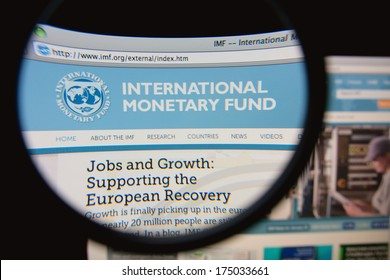 LISBON, PORTUGAL - FEBRUARY 5, 2014: Photo of the International Monetary Fund (IMF) homepage on a monitor screen through a magnifying glass.