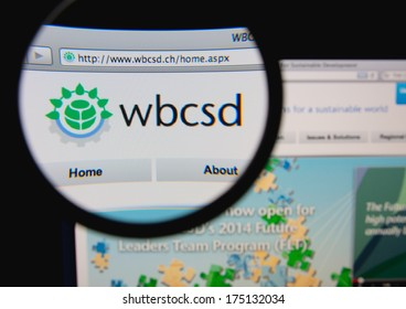 LISBON, PORTUGAL - FEBRUARY 6, 2014: Photo of World Business Council for Sustainable Development homepage on a monitor screen through a magnifying glass.