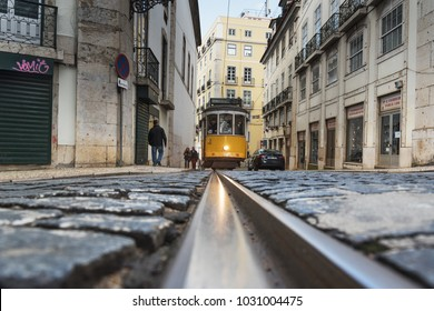 Lisbon, Portugal - FEBRUARY 7 , 2016 : typical old style tram passing narrow city street in Lisbon , Portugal.