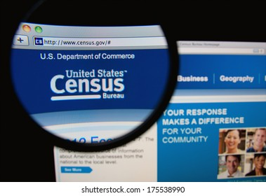 LISBON, PORTUGAL - FEBRUARY 8, 2014: Photo of the United States Census Bureau homepage on a monitor screen through a magnifying glass.