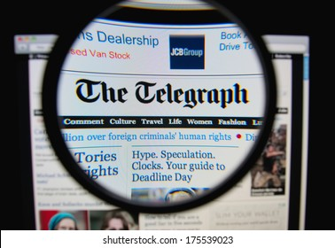 LISBON, PORTUGAL - FEBRUARY 8, 2014: Photo of The Telegraph homepage on a monitor screen through a magnifying glass.