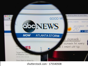 LISBON, PORTUGAL - FEBRUARY 8, 2014: Photo of ABC News homepage on a monitor screen through a magnifying glass.