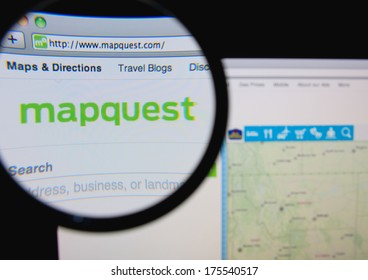 LISBON, PORTUGAL - FEBRUARY 8, 2014: Photo of Mapquest homepage on a monitor screen through a magnifying glass.