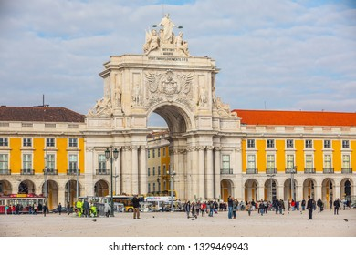 Lisbon, Portugal. January 04, 2019: Rua Augusta triumphal Arch in the historic center of the city of Lisbon in Portugal. People on the street walking. Blue sky with clouds.