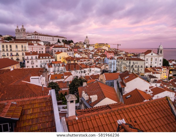 LISBON, PORTUGAL - JANUARY 10, 2017: Cityscape of Lisbon, Portugal, seen from Portas do Sol, at sunset.