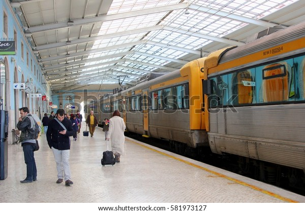 LISBON - PORTUGAL - January 19. Passengers are arriving and waiting for  departure of the commuter train to Tomar at a platform in Santa Apolonia train station on January19, 2017 in Lisbon.