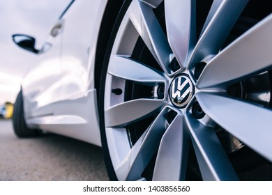 Lisbon, Portugal - January 27, 2019 A close-up of a titanium disk. white car Volkswagen. close up
