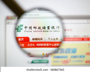 LISBON, PORTUGAL - JANUARY 7, 2016: Photo of Postal Savings Bank of China homepage on a monitor screen through a magnifying glass.