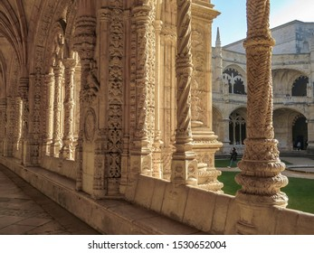 Lisbon, Portugal - Jenuary 2, 2019: Colonnade of the Jeronimos Monastery in Lisbon  - the most grandiose monument to late-Manueline Portuguese style architecture,  and Church of Santa Maria of Belem