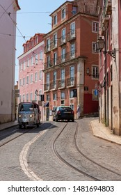 Lisbon, Portugal - July, 13, 2019:  Tuc Tuc transport in Largo das Portas do Sol  in the old town, Alfama neighborhood.