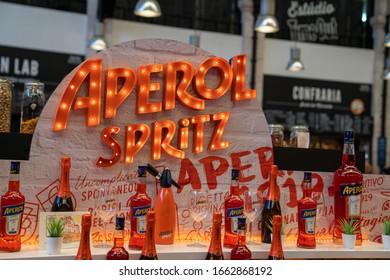 Lisbon, Portugal JULY 19, 2019: Aperol Spritz orange neon logo and display at custom bar at Time Out Market Lisbon