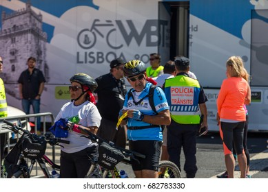 "LISBON, PORTUGAL - July 23,2017: Start event is ""World Bike Tour 2017"" on street of european city Liabon near tower of Belem and Padrao dos Descobrimentos."