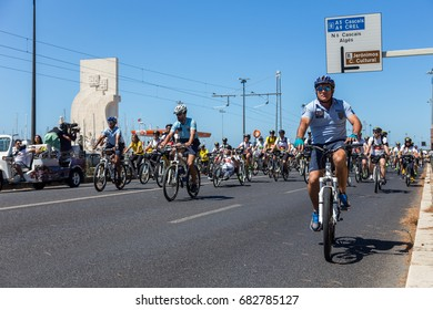"""LISBON, PORTUGAL - July 23,2017: Start event is """"World Bike Tour 2017"""" on street of european city Liabon near tower of Belem and Padrao dos Descobrimentos."""
