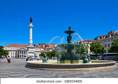 Lisbon, Portugal - July 25, 2009: View of the Rossio Square with tourists walking by, in the pombaline downtown of the city of Lisbon, Portugal