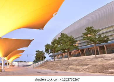 Lisbon, Portugal - July 3, 2016: Altice Arena - modern multipurpose venue and walkway with tensile membrane structures illuminated at dusk. Parque das Nacoes district of Lisbon Portugal.