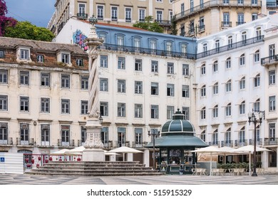 LISBON, PORTUGAL - JULY 4: Municipal square (Praca do Municipio) with the monument and typical kiosk-cafe in Lisbon, Portugal on July 4, 2016.
