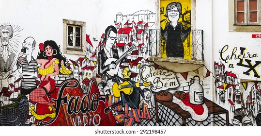 Lisbon, Portugal, July 7, 2013. Anonymous graffiti depicting traditional Portuguese fado vadio. This graffiti is a tourist attraction located in the old city.