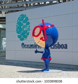 LISBON, PORTUGAL - JUNE 10, 2014: Colorful stylized statue of diver near the entrance to Lisbon Oceanarium.
