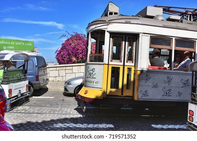 Lisbon, Portugal - June 11, 2017: lisbon traffic. Vintage yellow tram on a narrow street of romantic old Alfama