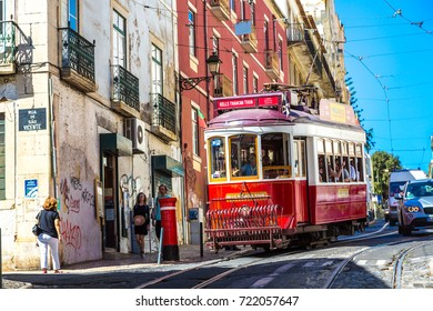 LISBON, PORTUGAL - JUNE 12, 2016: Vintage tram in the city center of Lisbon in a beautiful summer day, Portugal on June 12, 2016