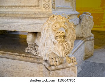 LISBON, PORTUGAL - JUNE 14, 2014: Marble lion supports the tomb of Alexandre Herculano, located in Jeronimos Monastery (Mosteiro dos Jeronimos in Portuguese) in Lisbon. Selective focus.