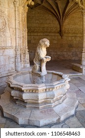 LISBON, PORTUGAL - JUNE 14, 2014: Fountain with lion sculpture in Jeronimos Monastery (Mosteiro dos Jeronimos in Portuguese) in Lisbon.