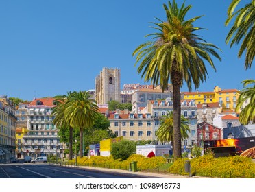 LISBON, PORTUGAL - JUNE 15, 2014: Old houses and Lisbon Cathedral in Alfama district in historic city center.
