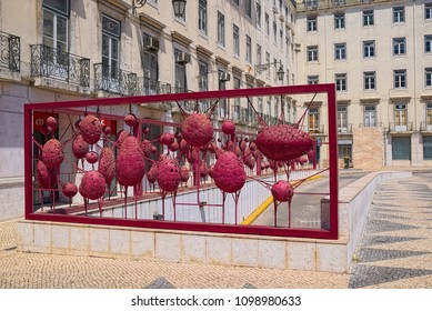 LISBON, PORTUGAL - JUNE 15, 2014: Red decorative fence along the entrance to underground parking at Town Hall Square of Lisbon city.