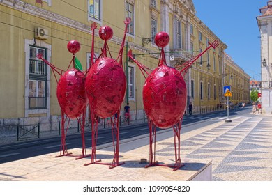 LISBON, PORTUGAL - JUNE 15, 2014: Three red stylized sculptures at side of Town Hall Square of Lisbon city.