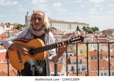 LISBON PORTUGAL . JUNE 16, 2017: Busker in Lisbon. The traveling musicians are one of the most typical images of the tourist areas of Lisbon