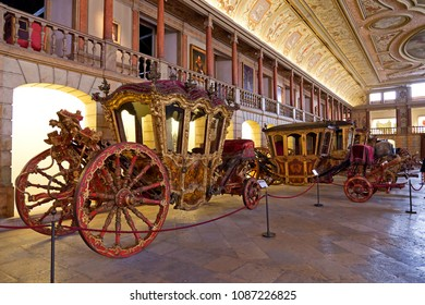Lisbon, Portugal - June 18, 2013: King Dom Joao V Coach. 18th century Baroque. Seen on Picadeiro Real, the previous main building of the Museu Nacional dos Coches (Coach Museum)
