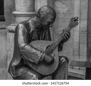 Lisbon, Portugal - June, 2016: A black and white picture of a sculpture representing the Fado music genre, traditional of Portugal.