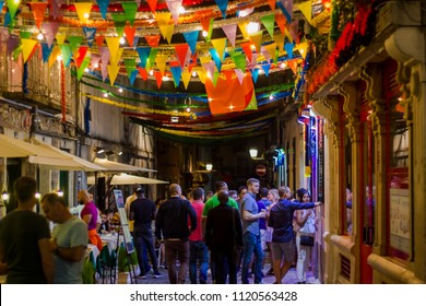 LISBON, PORTUGAL - JUNE 21, 2018: People in Lisbon street during popular saints festival