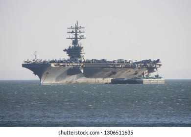 "Lisbon / Portugal - June 22, 2013: USS Dwight D. Eisenhower (CVN-69) (known informally as ""Ike"") anchored on the entrance of the Tagus river estuary, Lisbon, Portugal."