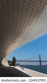 LISBON, PORTUGAL, JUNE 25 2018:  25 of April Bridge and Tagus River with beautiful sky from the main entrance of Museum of art, Architecture and Technology (MAAT).