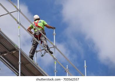Lisbon, Portugal - June 26, 2017: Secured worker on a scaffolding