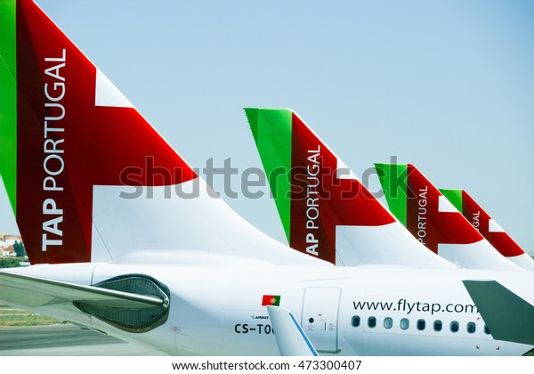 LISBON, PORTUGAL - JUNE 27 2015: Tails of four airplanes of the TAP Portugal airline company standing on the ground in a row.