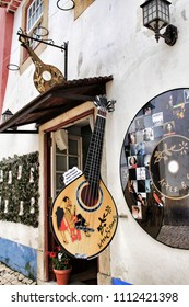 Lisbon, Portugal- June 3, 2018: Shop of fado music.Narrow and colorful streets, majestic facades, windows and balconies of the old village of Obidos, Portugal
