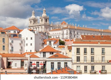 Lisbon, Portugal - June 5, 2018: Sao Vinte church on a hill above red rooftops in Lisbon. From the viewpoint of the upper district of Lisboa. Church of San Vicente de Fora.