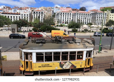 LISBON, PORTUGAL - JUNE 5, 2018: People ride the yellow tram in Praca Martim Moniz square in Lisbon, Portugal. Lisbon's tram network dates back to 1873 and is famous for its old style small streetcars