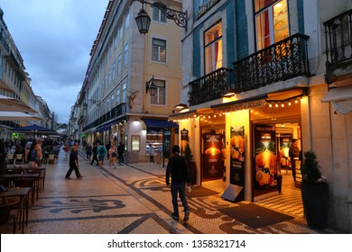 LISBON, PORTUGAL - JUNE 5, 2018: People visit Rua Augusta shopping street in Lisbon. Lisbon is the 11th-most populous urban area in the EU (2.8 million people).