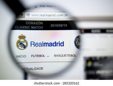 LISBON, PORTUGAL - June 6, 2015: Photo of:http: www.realmadrid.com, Real Madrid C.F.  homepage on a monitor screen through a magnifying glass.